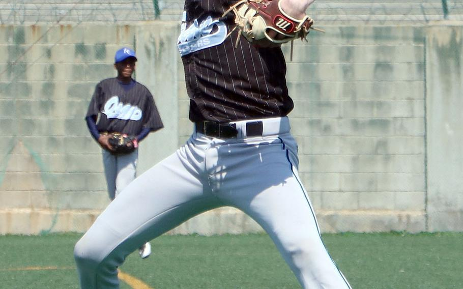 Osan's Carson Nugent delivers Saturday against Seoul American. Nugent survived nine walks and struck out six as the Cougars outlasted the Falcons 10-7.