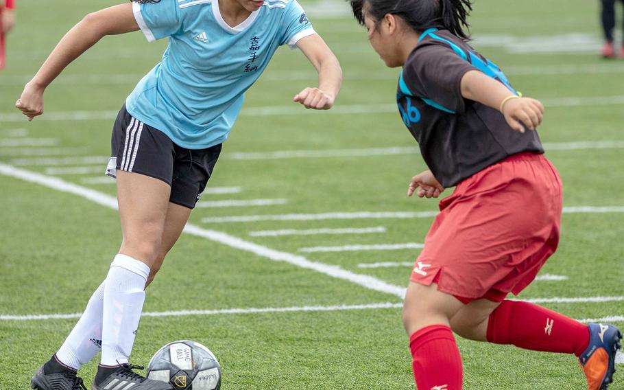 Kadena's Makayla Watts looks for operating room against Naha Shogyo during Saturday's girls soccer game, won by the Panthers 10-0.