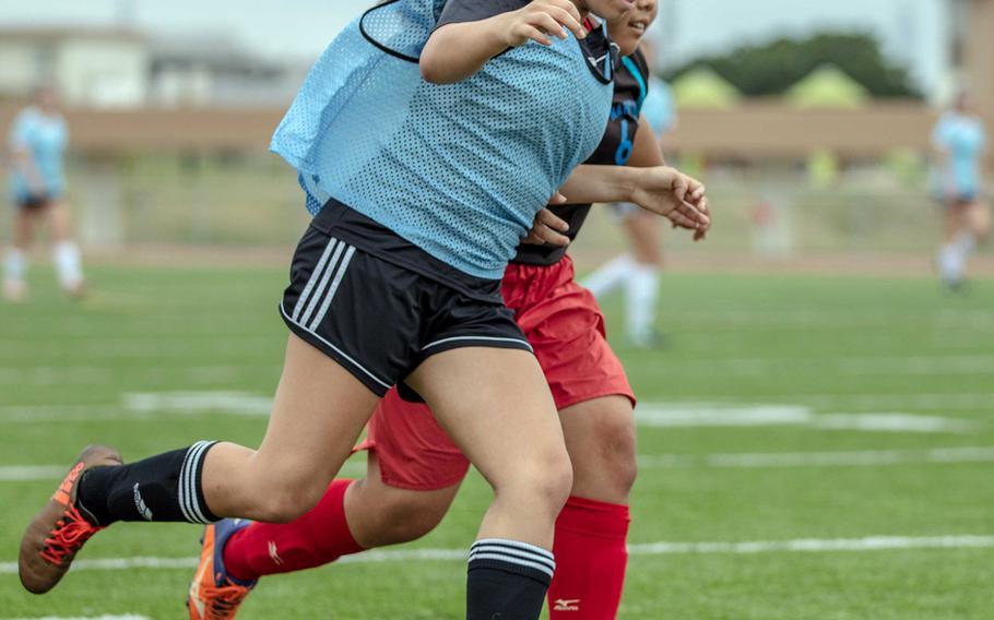 Kadena's Mikayla Benitez drives against Naha Shogyo during Saturday's girls soccer game, won by the Panthers 10-0.