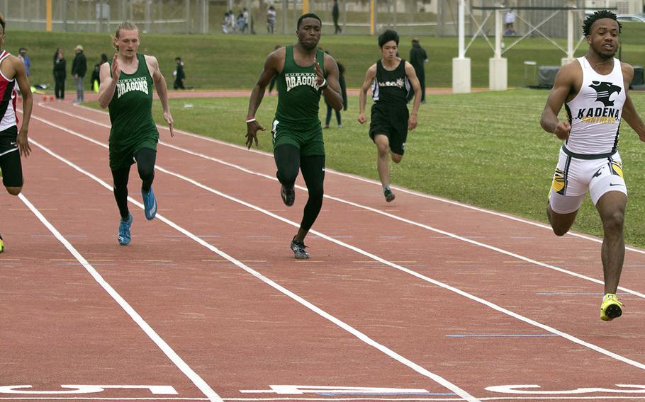 Kadena's Eric McCarter leads the field to the finish of the 100 meters during Saturday's Okinawa track and field meet. McCarter won both the 100 and 200.