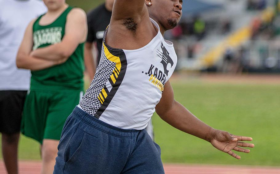 Kadena's Uriah Morris heaves the shot during Saturday's Okinawa track and field meet. Morris, a senior, won the shot put and discus in his debut as a Panther track and field athlete.