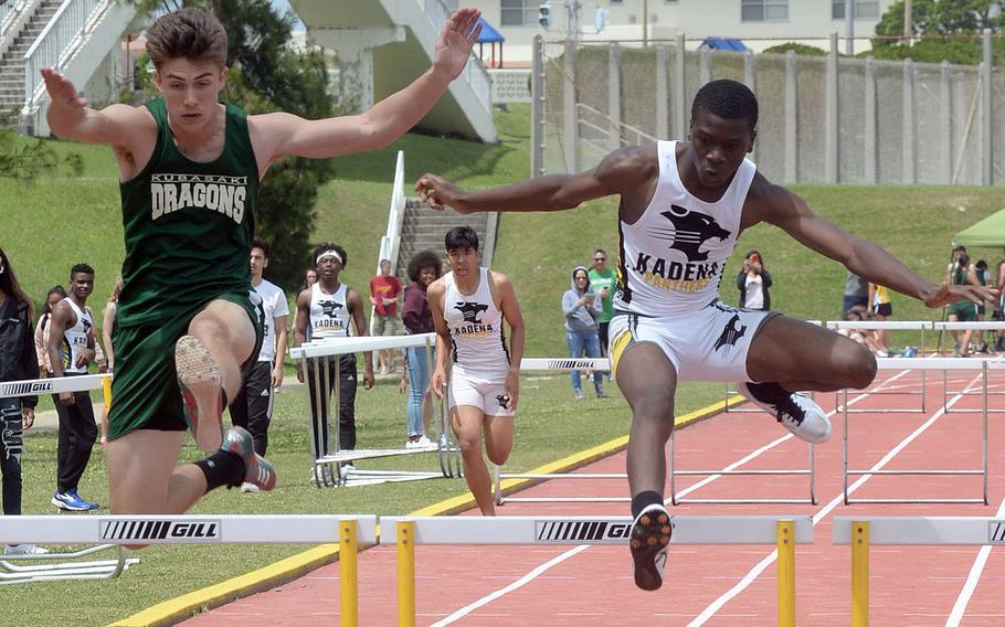 Kadena freshman Kevonte Speight and Kubasaki senior Dylan Galbraith go at it in the 300 hurdles during Saturday's Okinawa track and field meet. Speight edged Galbraith by .02 seconds, 46.91 to 46.93.