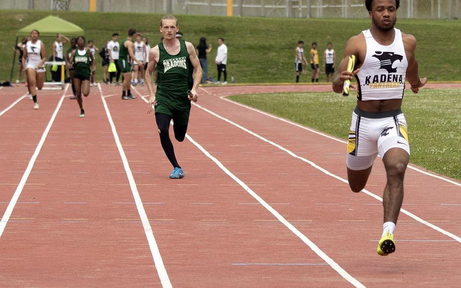 Kadena senior Eric McCarter pounds for the finsh of the 400 relay during Saturday's Okinawa track and field meet. The Panthers won all three relays, with McCarter also running a leg of the 1,600 relay and winning the 100 and 200 to boot.