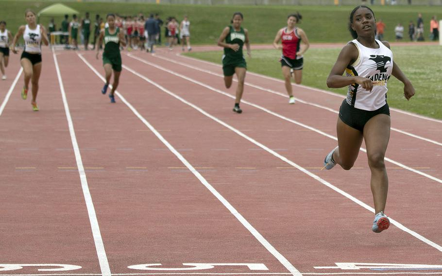 Kadena senior Keyyana Womack leaves the pack in her wake as she wins the 400 in 1 minute, 1.29 seconds during Saturday's Okinawa track and field meet.