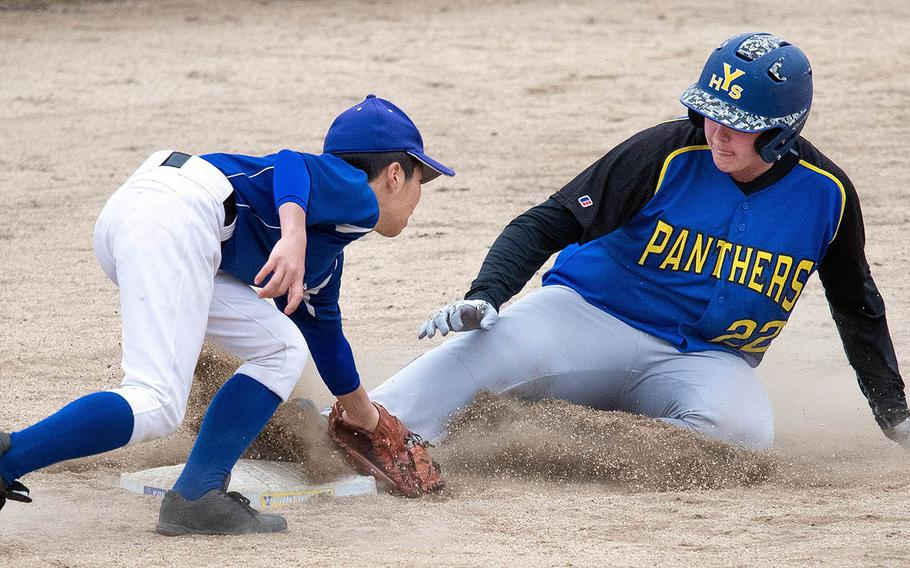 Yokota baserunner Nicholas Yates slides safely into second base against Yamate, a Japanese team, during Saturday's Japan baseball game. The Panthers lost 3-0, but rebounded to down Nile C. Kinnick 12-1 in Saturday's second game at Yokota Park