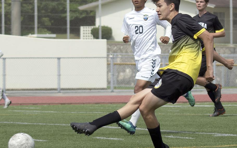 Kadena's Kael Beck boots the ball upfield against KBC Mirai during Sunday's Okinawa boys soccer match. The teams played to a 2-2 draw.