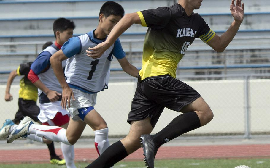 Kadena's Nao Heckerman dashes upfield with the ball against KBC Mirai during Sunday's Okinawa boys soccer match. The teams played to a 2-2 draw.