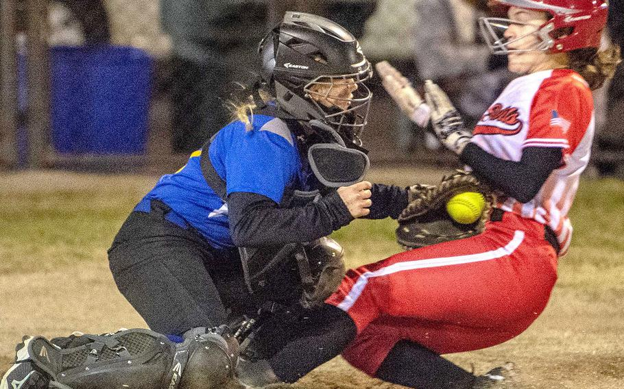 Nile C. Kinnick's Michaela Hall slides into the tag of Yokota catcher Becca Bauman during Tuesday's Japan softball game. The Red Devils won 17-9, ending the Panthers' eight-game winning streak.