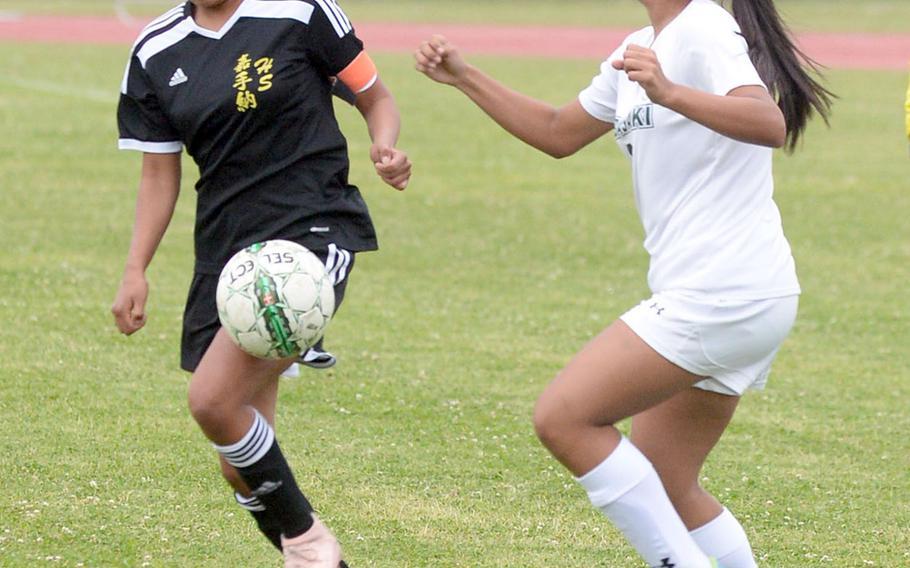 Kadena's Korina Radel plays the ball against Kubasaki's Angelica Figueroa during Wednesday's Okinawa girls soccer match, won by the Panthers 2-0.