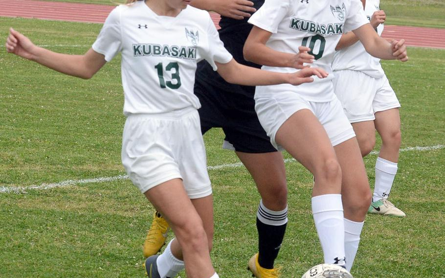 Kubasaki's Amara Mitton and Natalie Mulherin play keep away with the ball against Kadena's Alyssa Balbuena during Wednesday's Okinawa girls soccer match, won by the Panthers 2-0.