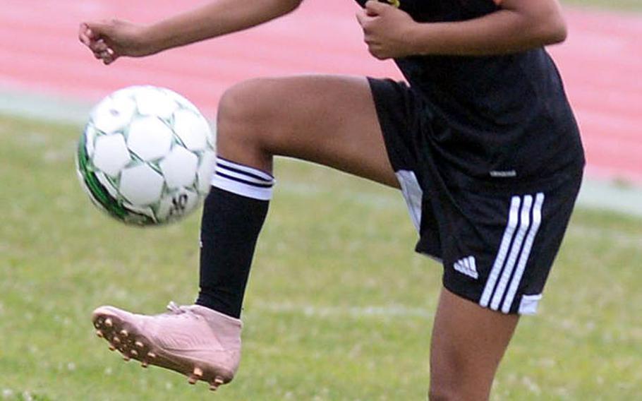 Kadena's Korina Radel settles the ball against Kubasaki during Wednesday's Okinawa girls soccer match, won by the Panthers 2-0.