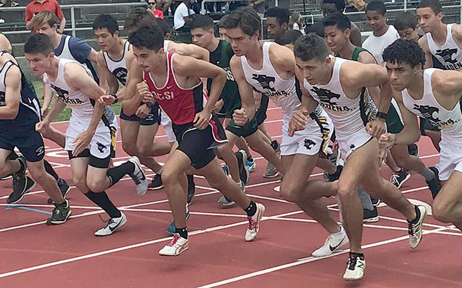 The boys field charges off the start line at the beginning of the 1,600 during Saturday's Mike Petty Meet.