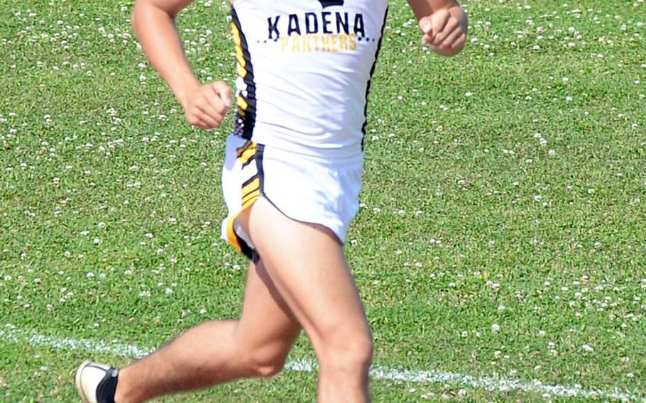 Kadena senior Hayden Bills heads down the home stretch of the 3,200 during Saturday's 15th Mike Petty Meet. Bills won in 10 minutes, 16.43 seconds.