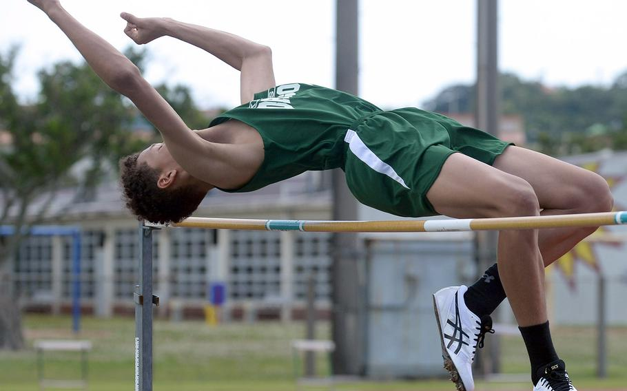 Kubasaki's Tristan Higginson clears the bar in the high jump during Saturday's 15th Mike Petty Memorial Meet at Kubasaki HIgh School. Higginson tied with Kadena's Xavier Peace at 5 feet, 8 inches.