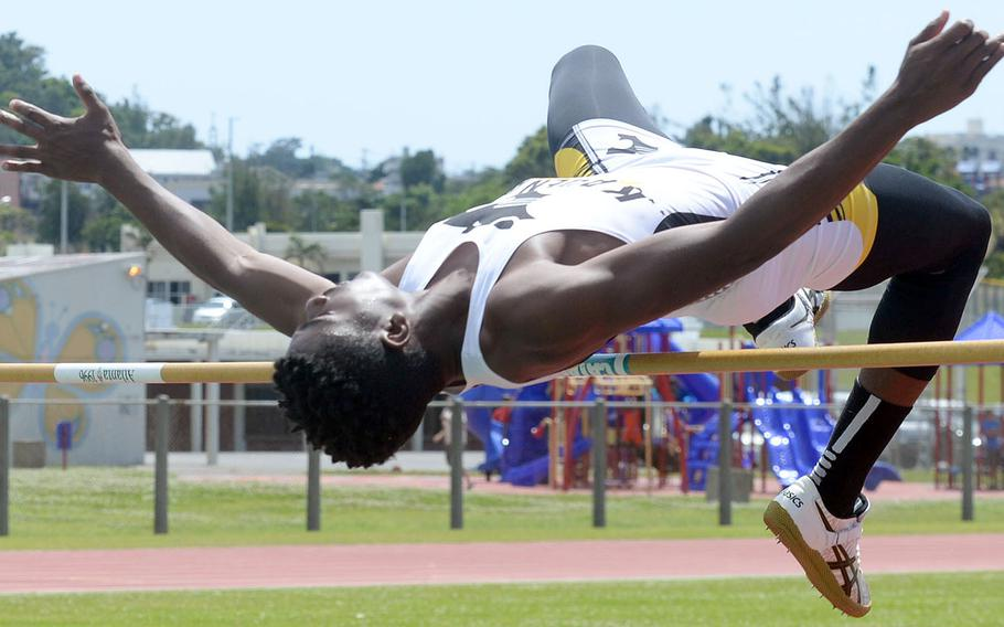 Kadena's Xavier Peace makes it over the bar in the high jump during Saturday's 15th Mike Petty Memorial Meet at Kubasaki HIgh School. Peace tied for second with Kubasaki's Tristan Higginson at 5 feet, 8 inches.