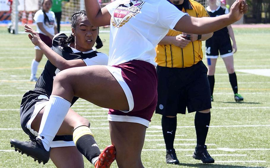 Matthew C. Perry's Taniya Smith and Zama's Kayesha McNeill battle for the ball during Thursday's DODEA-Japan girls soccer tournament opener. The Trojans won 3-0.