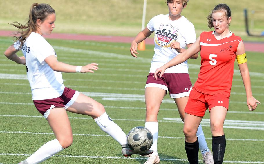 Matthew C. Perry's Micalya Feltner tries to field the ball in front of teammate Alex Young and E.J. King's Gabi Shultz during Friday's DODEA-Japan girls soccer tournament quarterfinal match. The Samurai won 3-0.