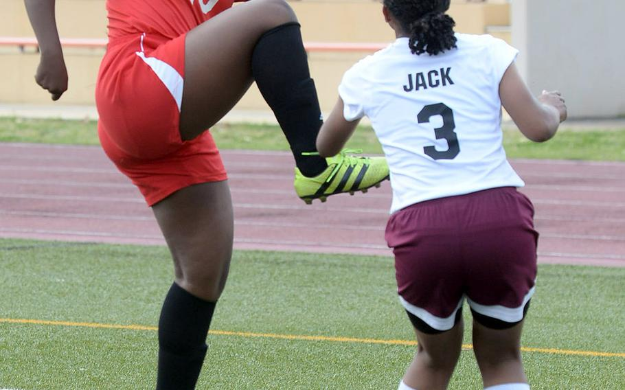 E.J. King's Jae Garland tries to field the ball against Matthew C. Perry's Sarita Jack during Friday's DODEA-Japan girls soccer tournament quarterfinal match. The Samurai won 3-0.