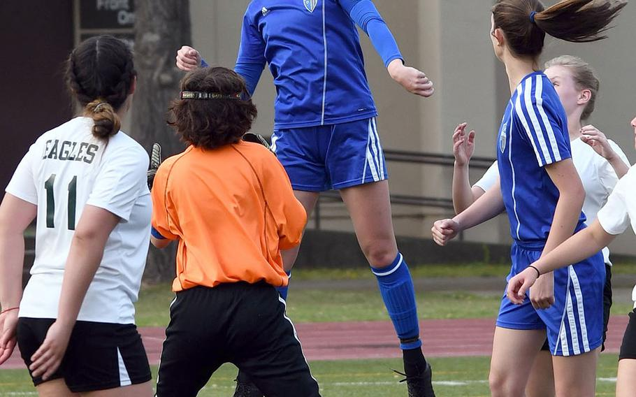 Yokota's Caleigh Garcia heads the ball off a corner kick against Robert D. Edgren during Friday's DODEA-Japan girls soccer tournament quarterfinal match. The Panthers won 8-0.
