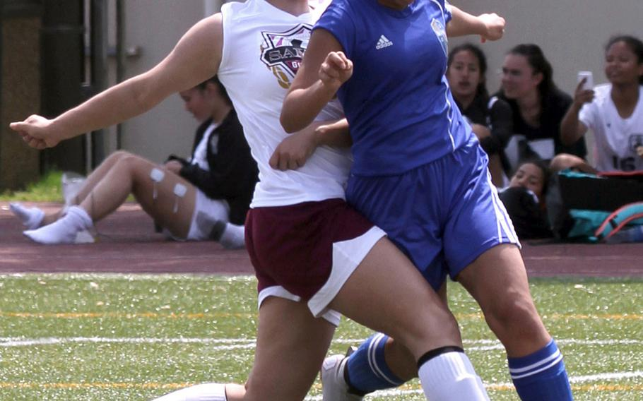 Matthew C. Perry's Hazel Bolduc and Yokota's Noelle Asato tangle for the ball during Friday's DODEA-Japan girls soccer match. The Panthers won 3-1.