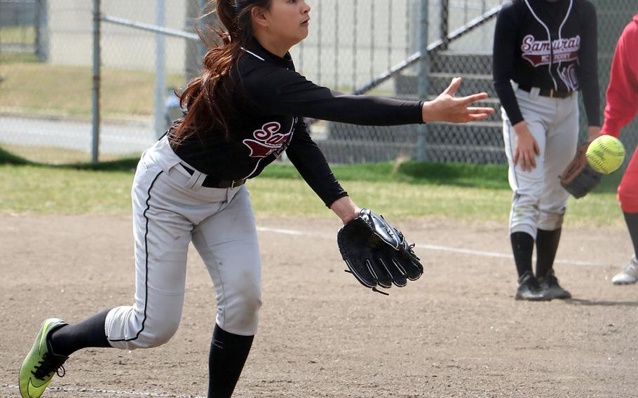 Matthew C. Perry's Xandra Bugawan delivers against Nile C. Kinnick during Friday's DODEA-Japan softball tournament game. The Red Devils won 10-0.
