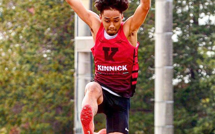 Nile C. Kinnick's Chris Watson leaps to victory in the long jump during Saturday's track and field meet at Yokota. Watson also won the 100 and 200.