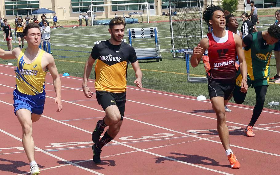 Nile C. Kinnick's Chris Watson, third from left, comes across the line first in the 100-meter dash during Saturday's track and field meet at Yokota.