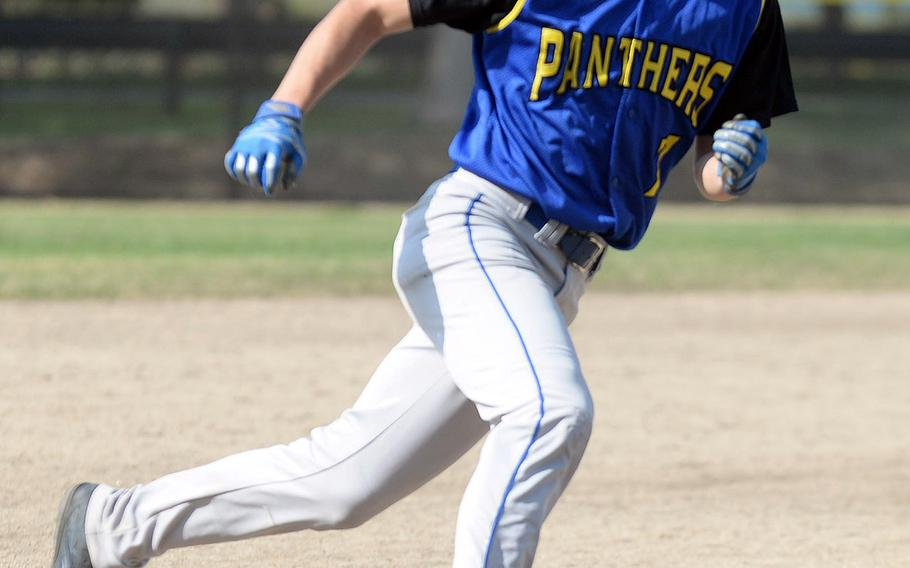 Yokota baserunner Glen Willingham charges around third base and heads for home against E.J. King during the final game Saturday in the DODEA-Japan baseball tournament. The Panthers won 8-0 to finish 4-0 and win the tournament for the fourth straight year.