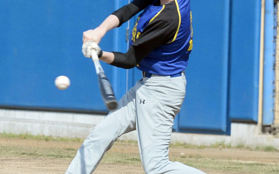 Yokota's Luke Wiedie makes contact against E.J. King during the final game Saturday in the DODEA Japan baseball tournament. The Panthers won 8-0 to finish 4-0 for the tournament and win the title for the fourth straight year.