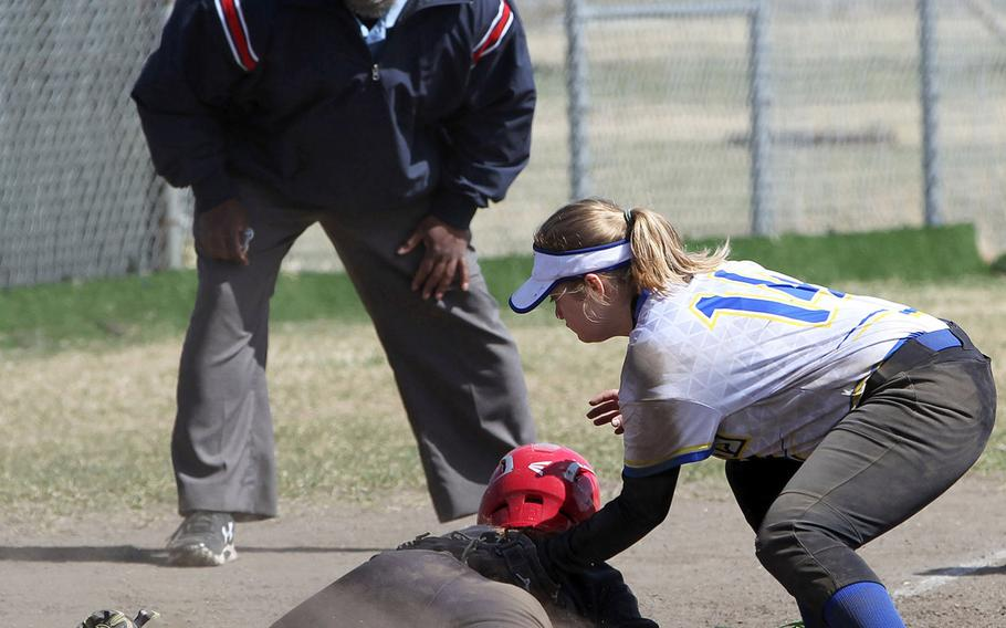 Nile C. Kinnick baserunner Michaela Hall is safe at third under the tag of Yokota's Isabella Garcia during Saturday's DODEA-Japan softball tournament final. The Panthers won 11-9.