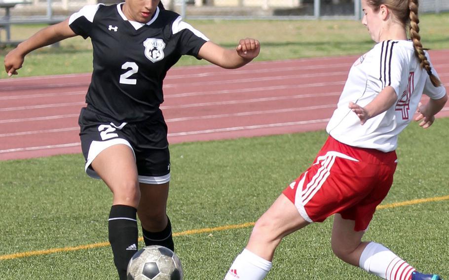 Zama's Fabiola Ayala-Rivera boots the ball against Nile C. Kinnick's Arwyn St. John' during Saturday's DODEA-Japan girls soccer tournament final. The Red Devils won 4-0.