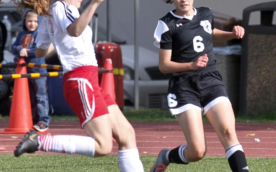 NIle C. Kinnick's Jillian Mock and Zama's Meridean Duarte chase the ball during Saturday's DODEA-Japan girls soccer tournament final. The Red Devils won 4-0.