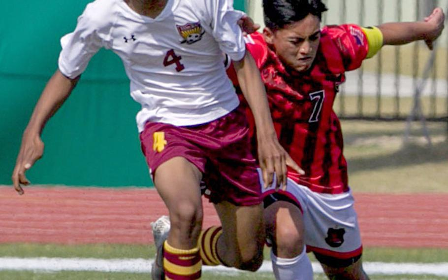 Nile C. Kinnick's Jazel Mendoza and Matthew C. Perry's Shion Fleming battle for the during Saturday's DODEA-Japan boys soccer tournament final. The Samurai won 4-1.