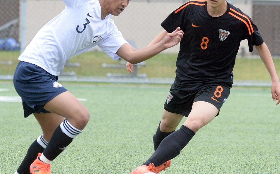 Osan's Lean Copia starts upfield against Seoul International's Eddie Hahm during Friday's Korea boys soccer Plate Tournament at Osan Air Base. The host Cougars won 3-0.