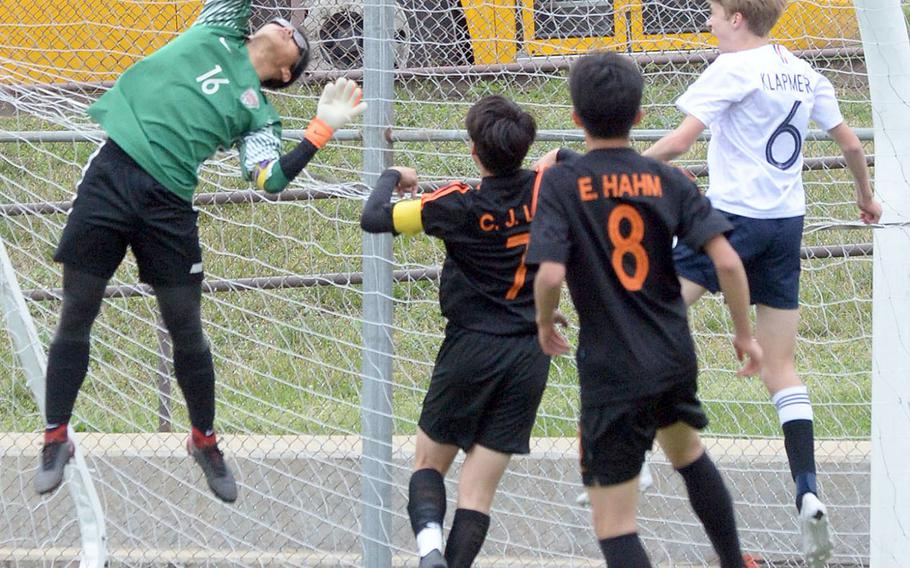 Seoul International goalkeeper Haanbi Kim can't quite get a hand on a shot toward the corner of the net against Osan during Friday's Korea boys soccer Plate Tournament at Osan Air Base. The host Cougars won 3-0.