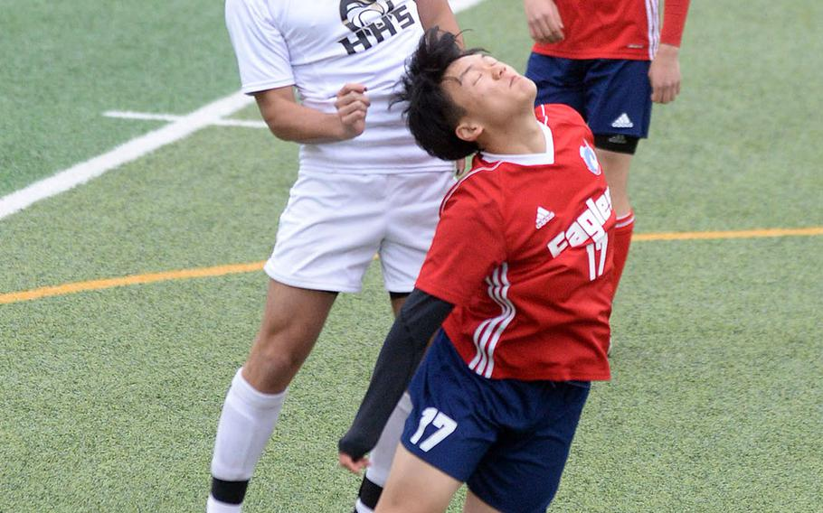 Humphreys' Devin Donnell and International Christian-Uijongbu's Peter Tsung go up to head the ball during Friday's Korea boys soccer Plate Tournament match at Osan Air Base. The Blackhawks won 8-0.