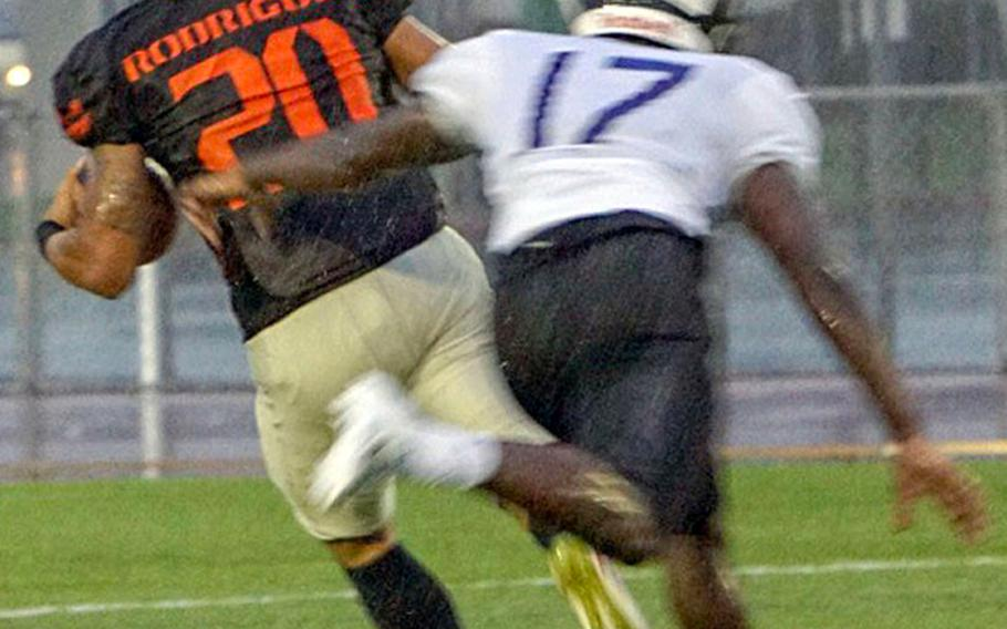 Hansen's Jeromy Rodriguez leaves Okinawa defensive back Keelan Jones in his wake. Rodriguez caught five passes for 120 yards and a touchdown to pace the Outlaws' offense.