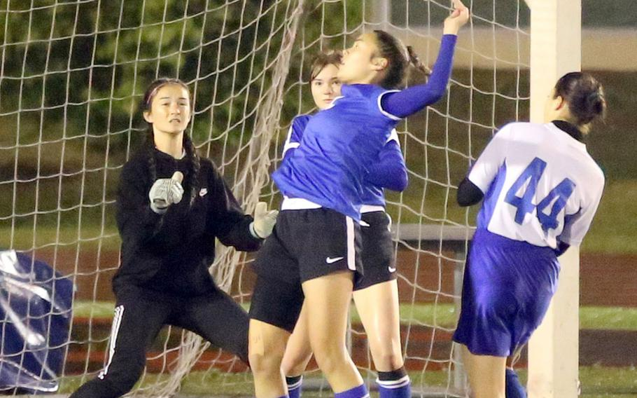 Yokota's Caleigh Garcia tries to settle the ball in front of goalkeeper Emily Taynton and Christian Academy Japan's Mei Kimura during Tuesday's Japan girls soccer match, won by the Panthers 2-0.