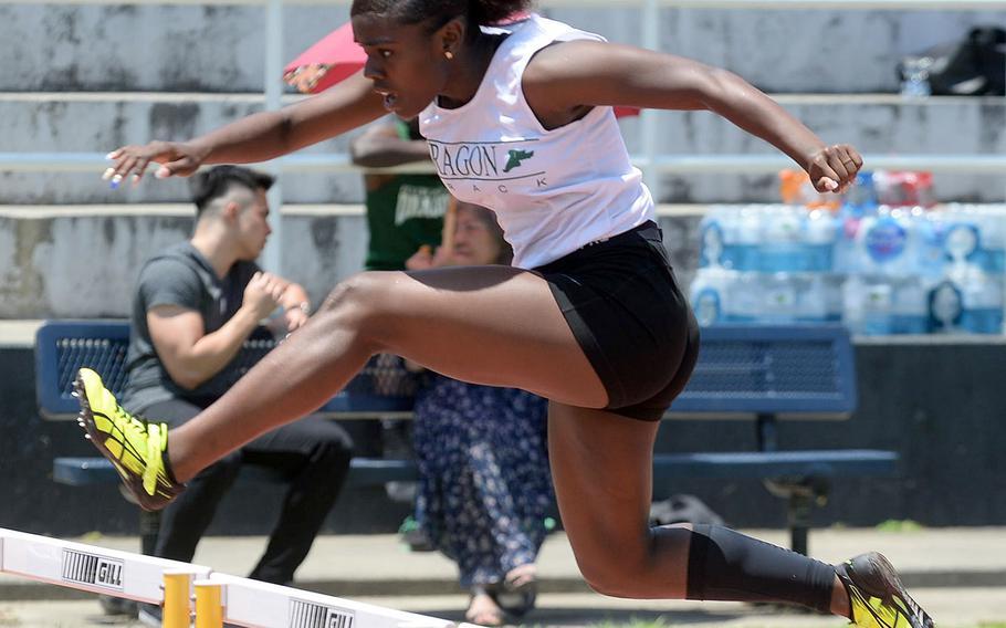 Kubasaki's Jaidah Davis makes her way over the next-to-last hurdle in Saturday's Okinawa district finals 300 hurdles.