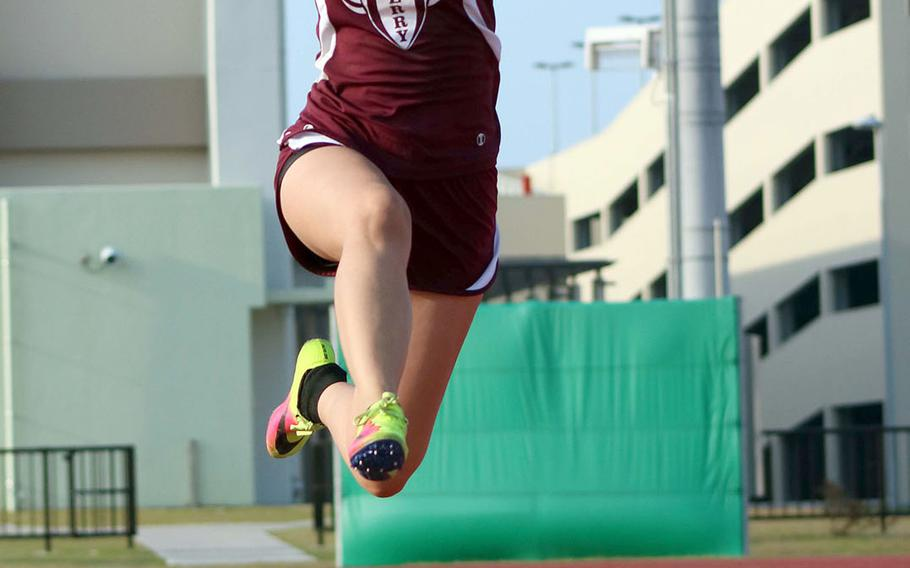 Matthew C. Perry's Kaitlyn Flynn leaps to victory in the long jump during Saturday's Samurai Invitational.