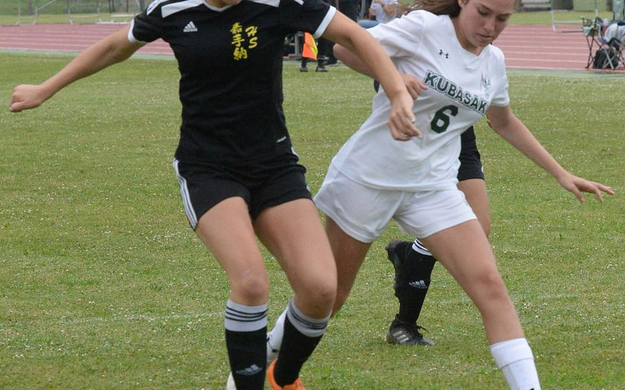 Kadena's Megan Kirby and Kubasaki's Veronica Monroy battle for the ball during Friday's Okinawa girls soccer match. Kirby scored a hat trick, giving her a Pacific-best 28 goals on the season, as the Panthers won 7-2 to sweep the season series.