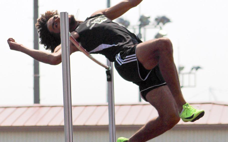 Humphreys' Quintin Metcalf clears the bar at 1.9 meters during Saturday's Korea district track and field finals. He took first place and leads the Pacific in the event this season.