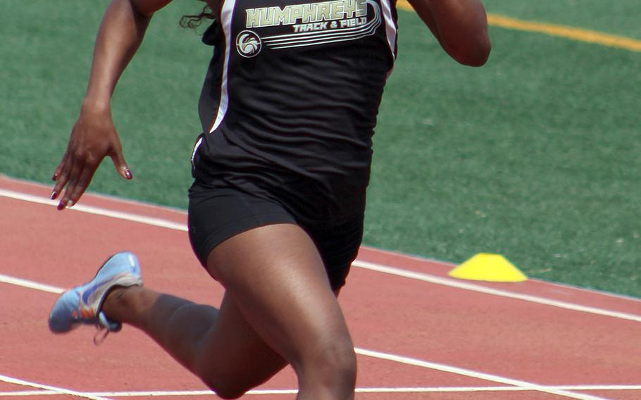 Humphreys' Jaela Higgs makes her way down the stretch during Saturday's Korea district track and field finals. Higgs won the 100, 200 and 400.