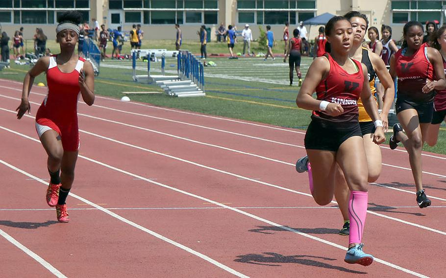 Nile C. Kinnick's Debrianna Ellis leads the pack to the finish in the girls 200 during Saturday's Kanto Plain track and field finals. Ellis finished first in the 100, 200 and 400.