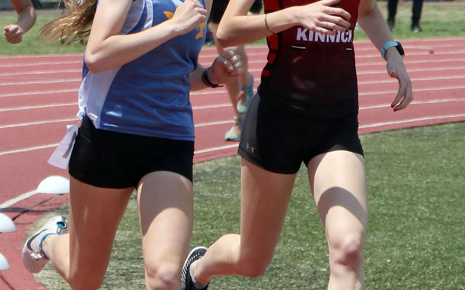 Yokota's Aiko Galvin and Nile C. Kinnick's Annabel Stafford run side-by-side around the turn during Saturday's Kanto Plain track and field finals. Galvin won the 800 and 1,600; Stafford came in second in the 800 and third in the 1,600.