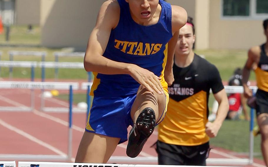 St. Mary's Kouki Wood negotiates the final hurdle en route to first place in the 300 hurdles during Saturday's Kanto Plain track and field finals.