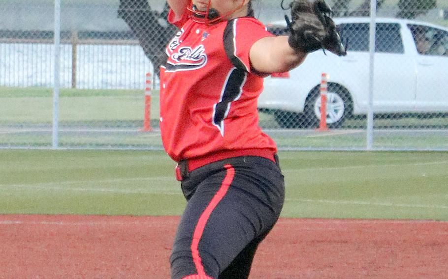 Nile C. Kinnick's Tori Osterbrink kicks and delivers against Yokota during Friday's Japan softball game. Osterbrink struck out 14 Panthers and the Red Devils rallied for four runs in the last of the eighth inning to beat Yokota 6-4.