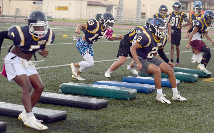 Guam High players go through agility drills during a three-day combine at Yokota.