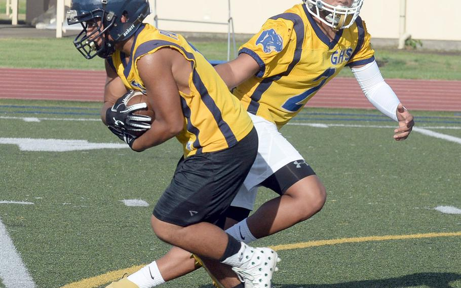 Quarterback Travon Jacobs and running back Julius Gaduang give Guam High's skills positions an experience edge. It's the line that needs developing, and quickly.