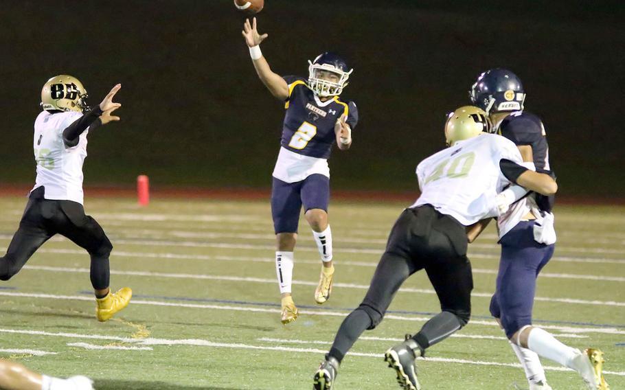 Guam High quarterback Travon Jacobs unleashes a pass against the Tiyan defense.
